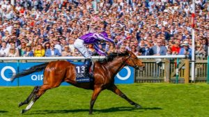 A packed Newmarket crowd sees Saxon Warrior home in the 2,000 Guineas.