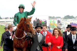 New Approach ridden by Kevin Manning with HH Sheikh Mohammed and HRH Princess Haya (Galop Magazine).