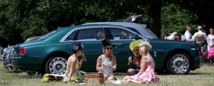 Racegoers relax in the car park at Ascot.