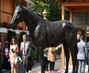 Frankel's 2012 Juddmonte International win at York was beyond impressive. Here, his bronze checks out the arriving Owners & Trainers.