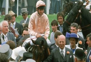 Steve Cauthen on Slip Anchor with owner Lord Howard de Walden - trainer Henry Cecil is in the background.
