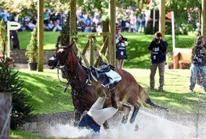 Zara Tindall dives into the water at Burghley at the weekend.