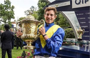 James Doyle holds the King George Trophy after bringing Poet's Word home in one of the great finishes.