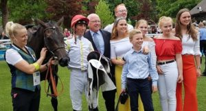 PETER Savill with young partners in his Kodiac 2yo filly raiding a Listed race at Deauville - the waistcoat on the filly's handler confirms that the trainer is Mark Johnston.