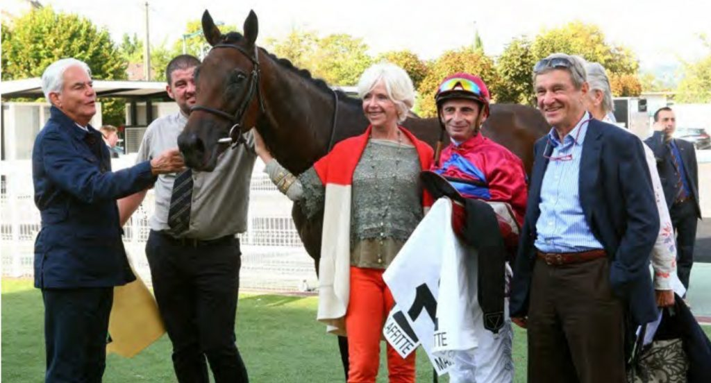 AIM TO PLEASE –Winner of the Group 3 Prix Bertrand de Tarragon at Maisons-Laffitte 21st September 2016 By Excellent Art out of an Anabaa Blue mare. Owned by Mr J Vasicek, bred by Haras D'Ecouves with Elizabeth Doumen at the filly's head, trained by François Doumen speaking to the filly, ridden by Gérard Mossé.